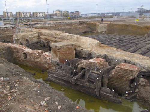 Storehouse foundations with the timber slipways behind. J. D. Davies.